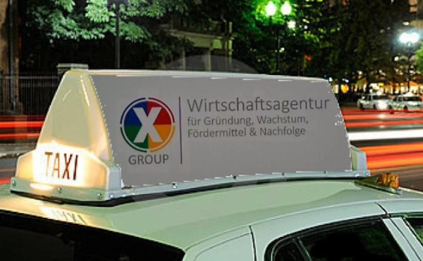 Taxiwerbung der Wirtschaftagentur X-Group für Gründerseminare Berlin